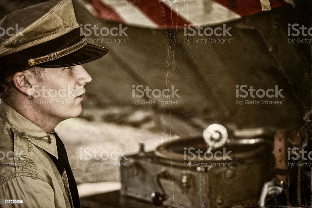 Naval Officer And Old Phonograph In A Tent On Site stock photo