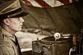 Naval Officer And Old Phonograph In A Tent On Site