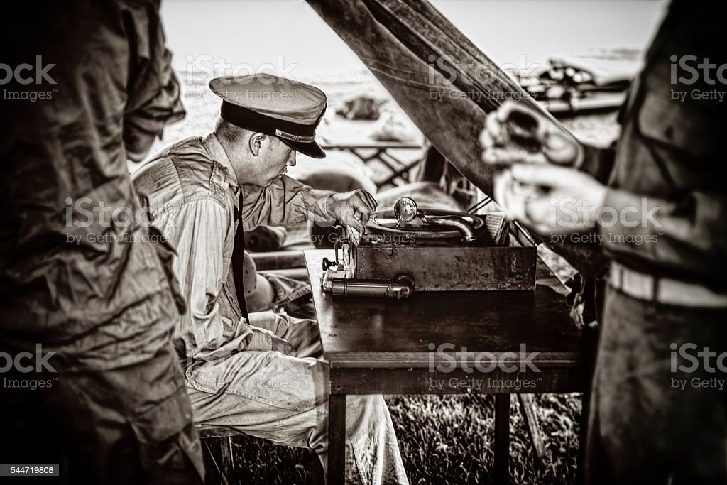 Naval Officer Enjoying The Music On His Vintage Phonograph stock photo