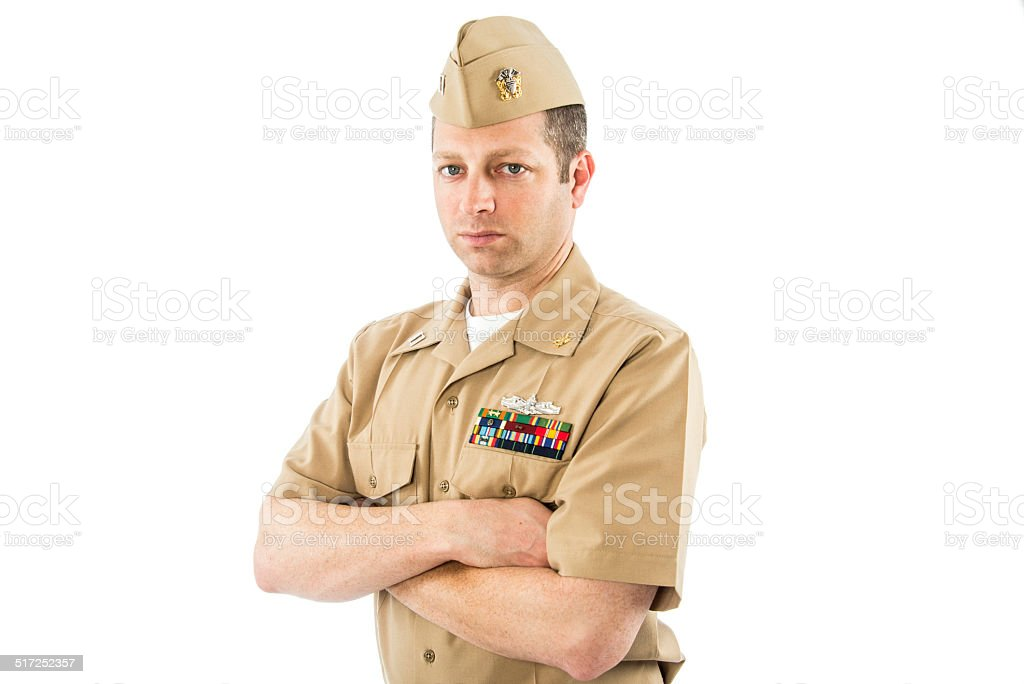 Naval Officer With His Arms Crossed Isolated on White stock photo