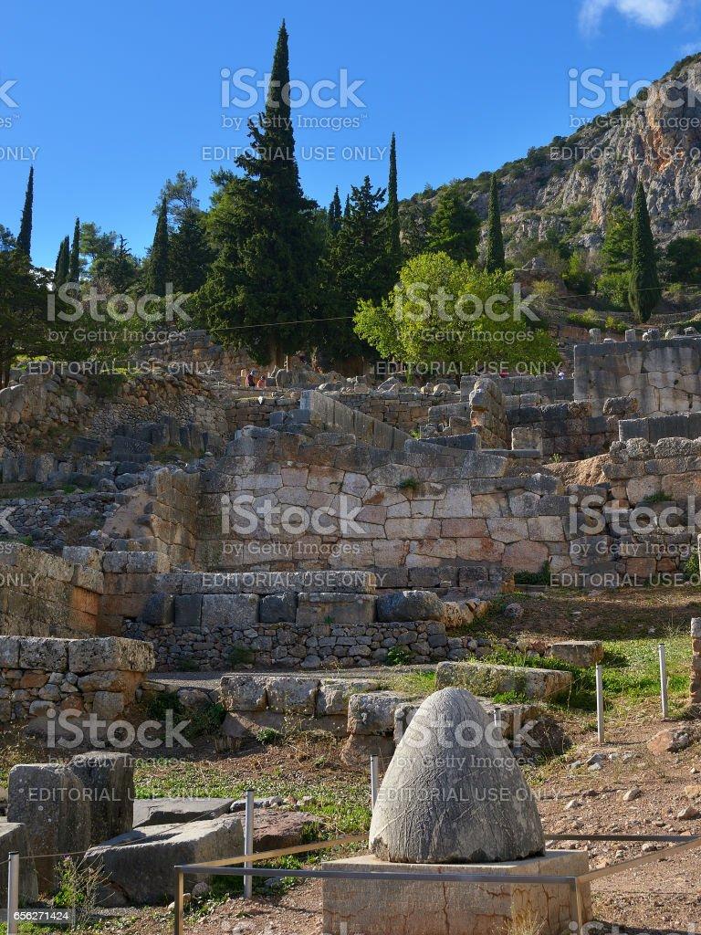 Navel stone in Delphi, Greece stock photo