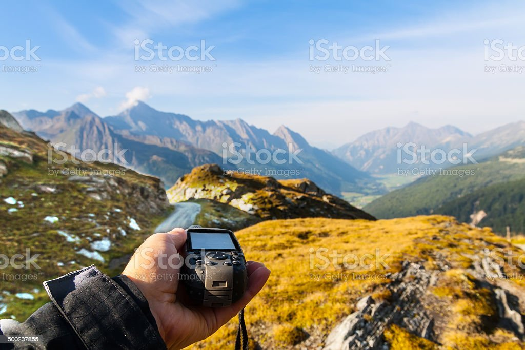 Navigate with GPS in the mountain stock photo