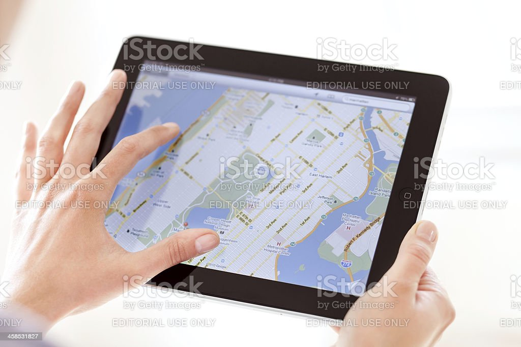 Navigating on Apple iPad royalty-free stock photo