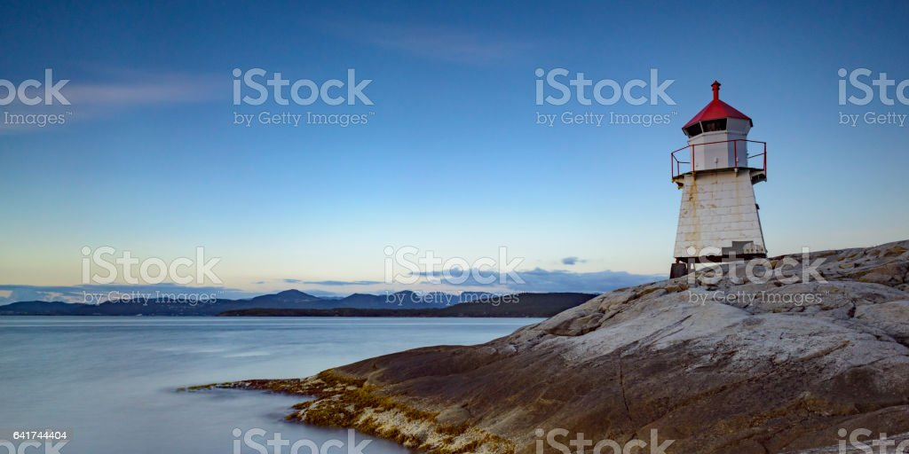 Navigation beacon on Tingholmen in Norway during sunset stock photo