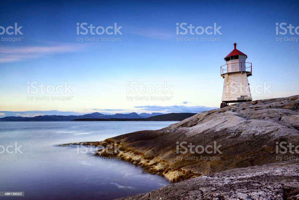 Navigation beacon on Tingholmen island in Norway during sunset stock photo