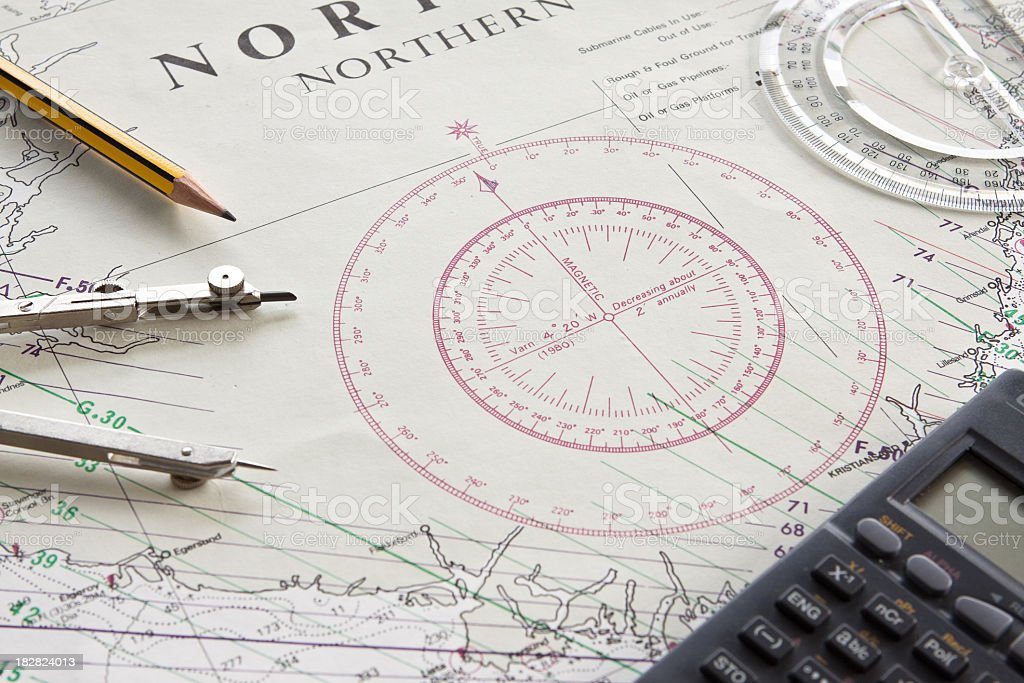 A navigation charting map with compass and a calculator royalty-free stock photo