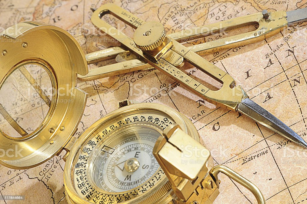 navigation device on a background an old map royalty-free stock photo