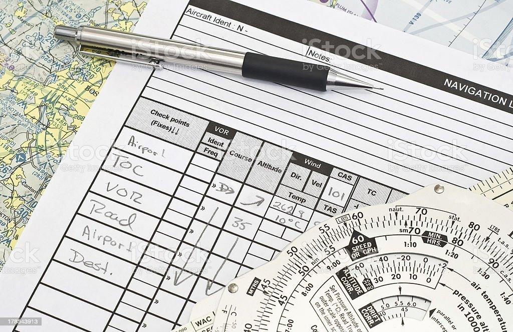 Navigation log and E6B stock photo