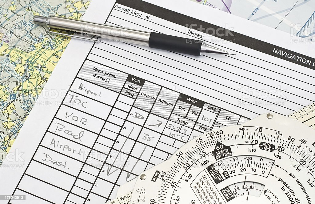 Navigation log and E6B stock photo