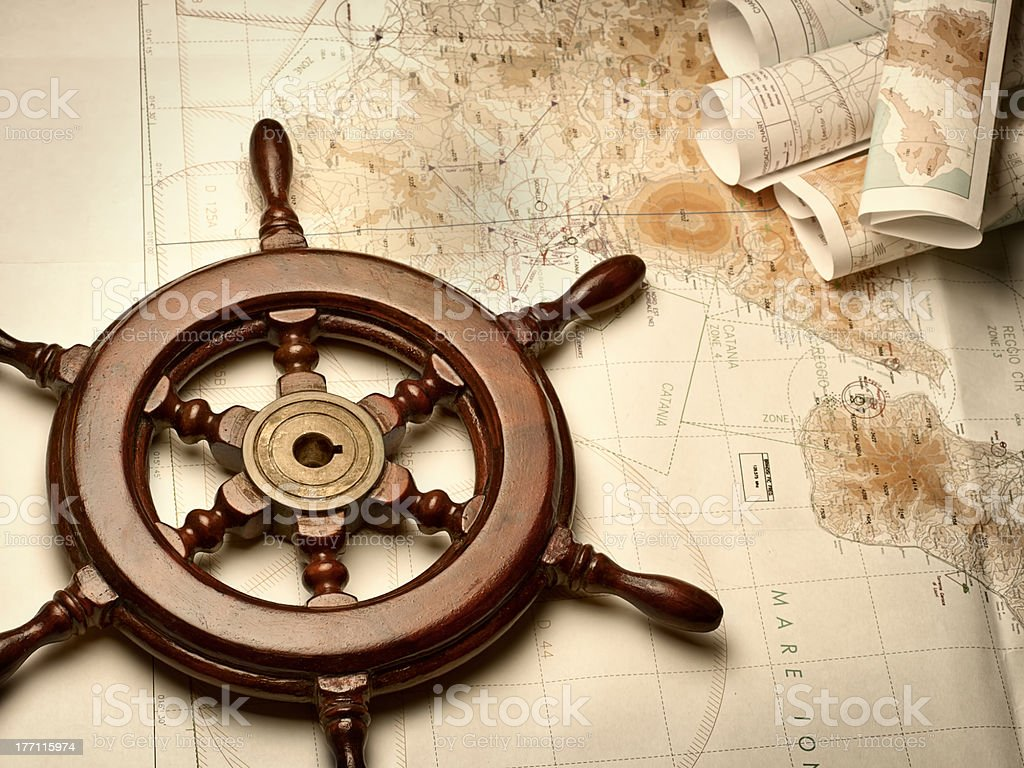 Navigation maps and helm stock photo