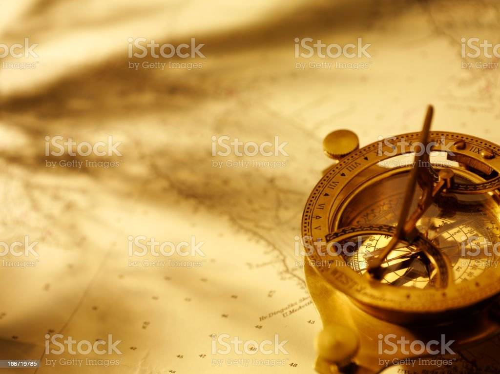 Navigation with a Brass Compass stock photo