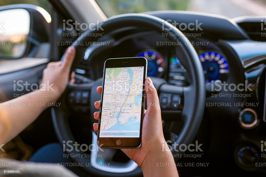 Navigation with iPhone in car stock photo