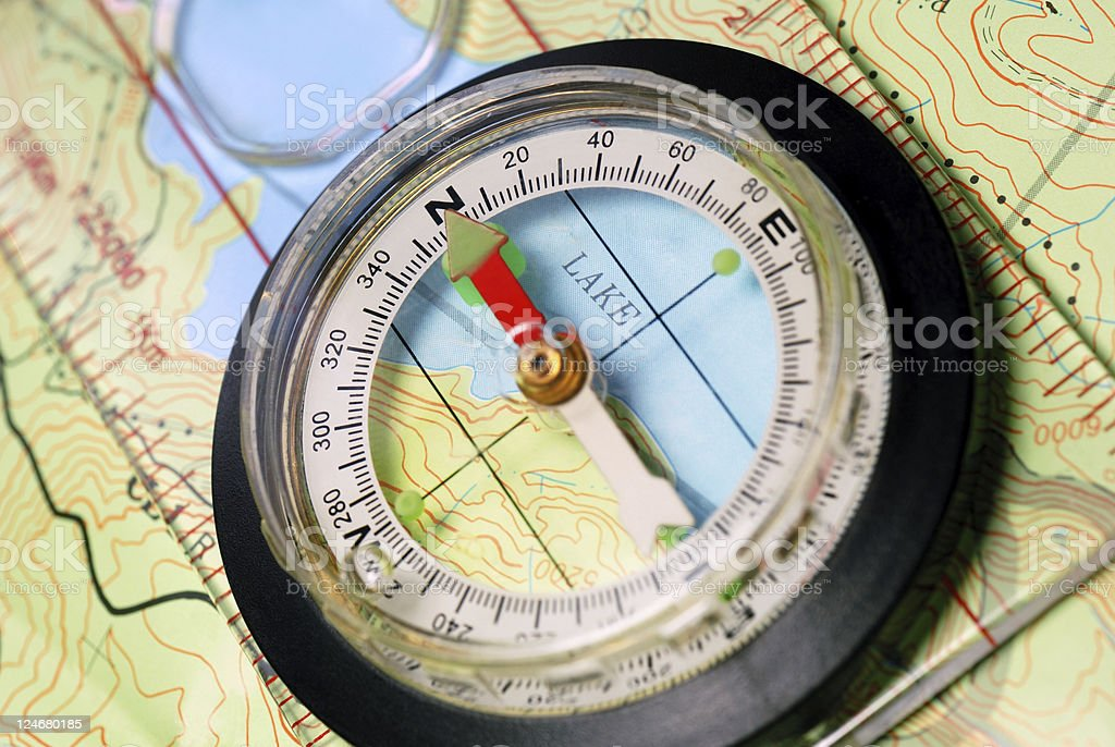 Navigational Compass on Topographical Map stock photo