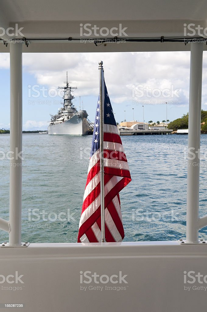 U.S. Navy and American flag in Pearl Harbor Hawaii stock photo