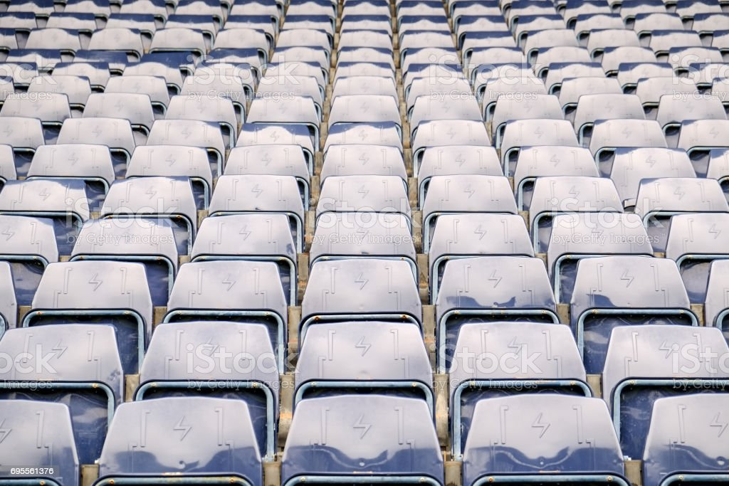 navy blue grandstand seats in stadium stock photo