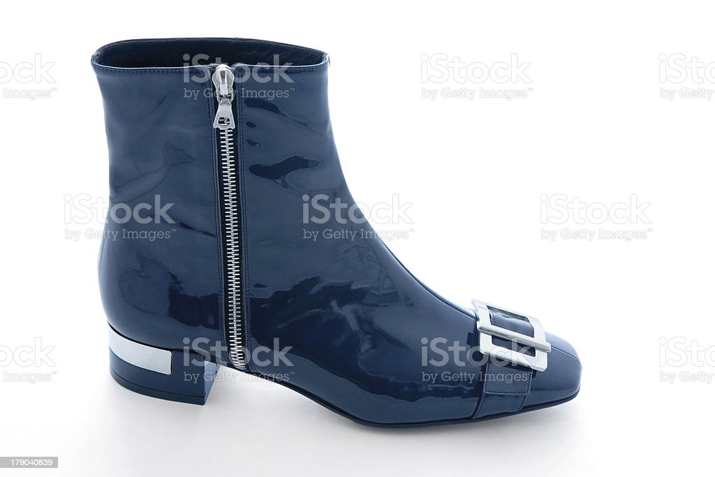 Navy blue patent leather zipped bootie royalty-free stock photo