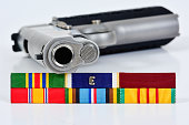 Navy campaign ribbons with a model 1911 .45 caliber pistol