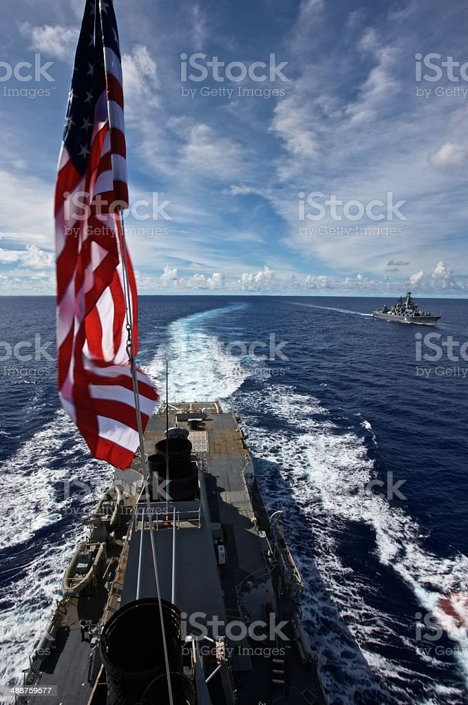 Navy Destroyer during Tactical Maneuvers stock photo