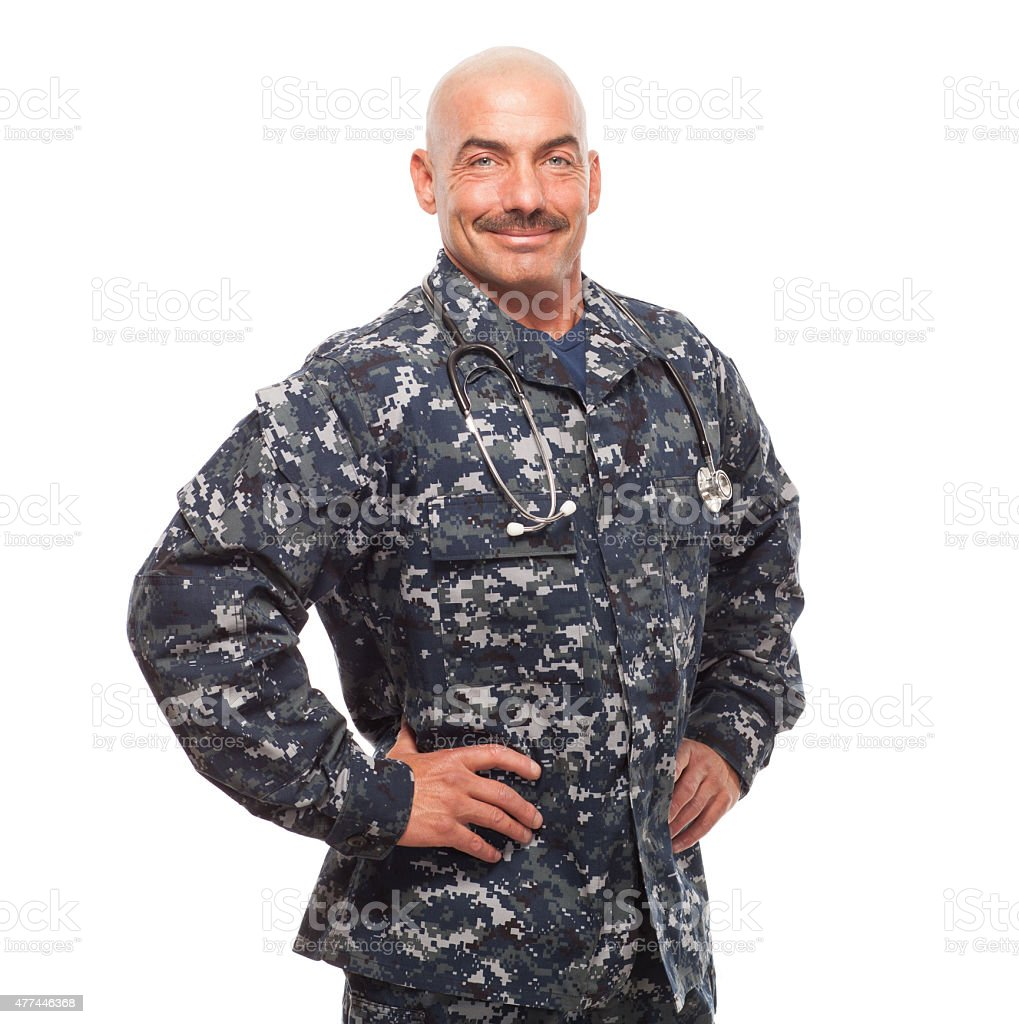 Navy doctor with hands on hips. stock photo