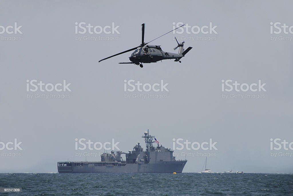 Navy helicopter and battleship stock photo