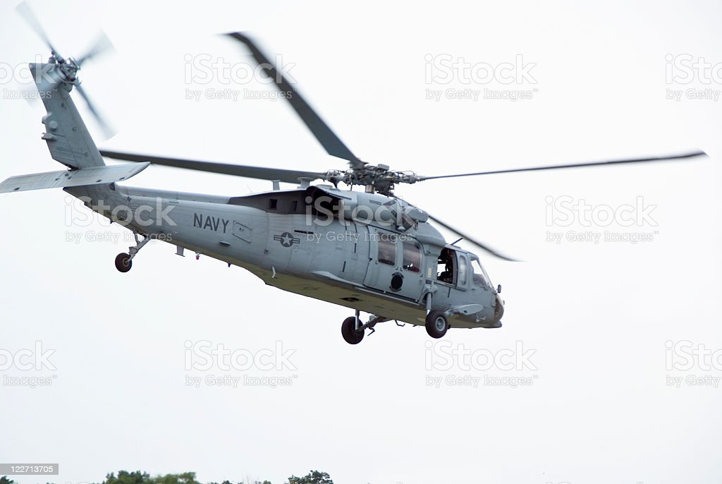 Navy Helicopter Lifting Off stock photo