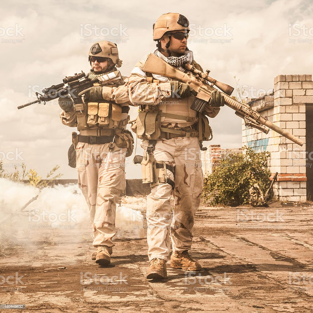 Navy SEALs in action stock photo