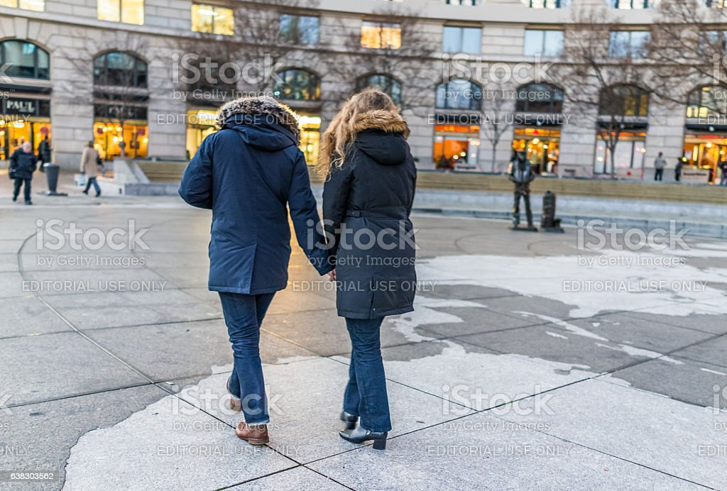 Navy yard memorial with couple walking on Pennsylvania avenue stock photo