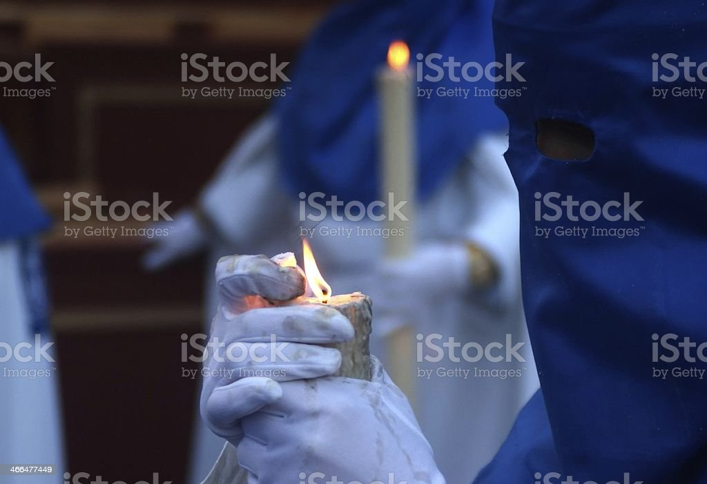Nazarene carrying a candle stock photo