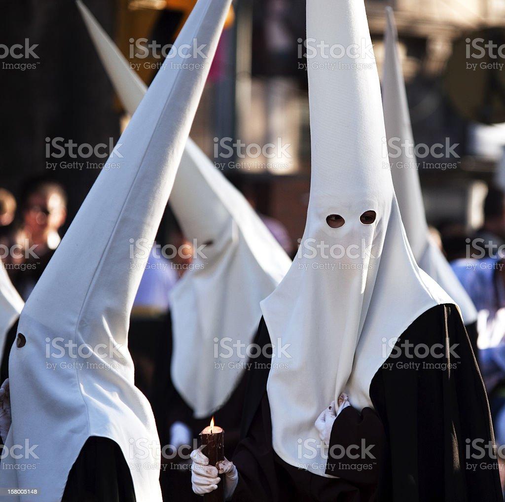 Nazarenos during Semana Santa in Malaga, Spain stock photo