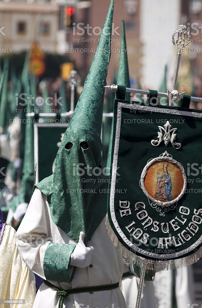 Nazarenos parading during Semana Santa in Malaga, Spain stock photo