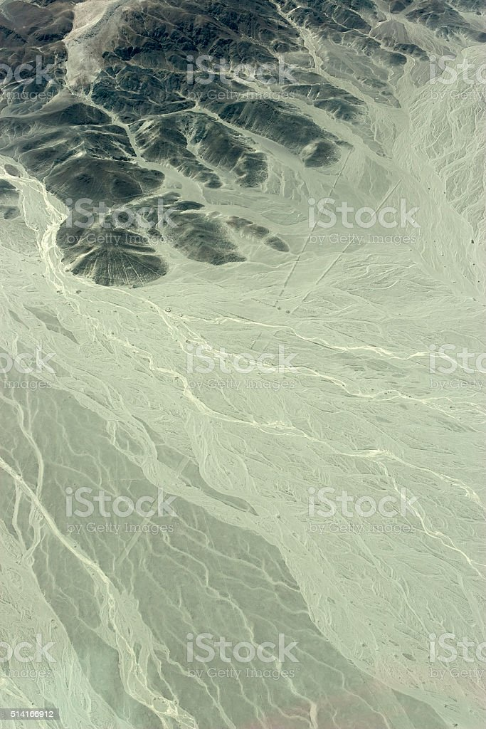 Nazca Peru ancient geoglyph trapezoid lines eroded in landscape stock photo