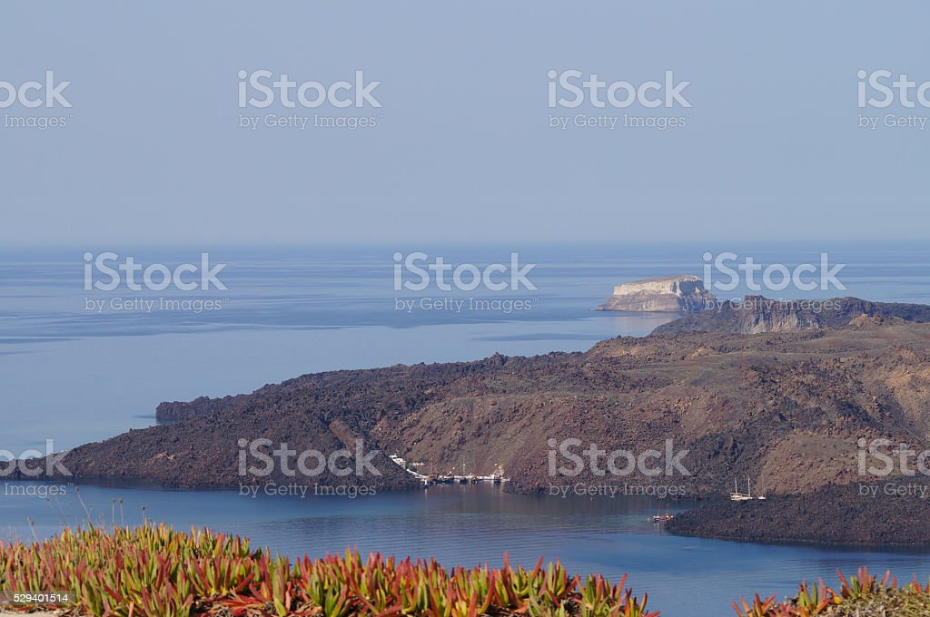 Nea Kameni Volcanic Island on the Aegean Sea in Santorini. stock photo