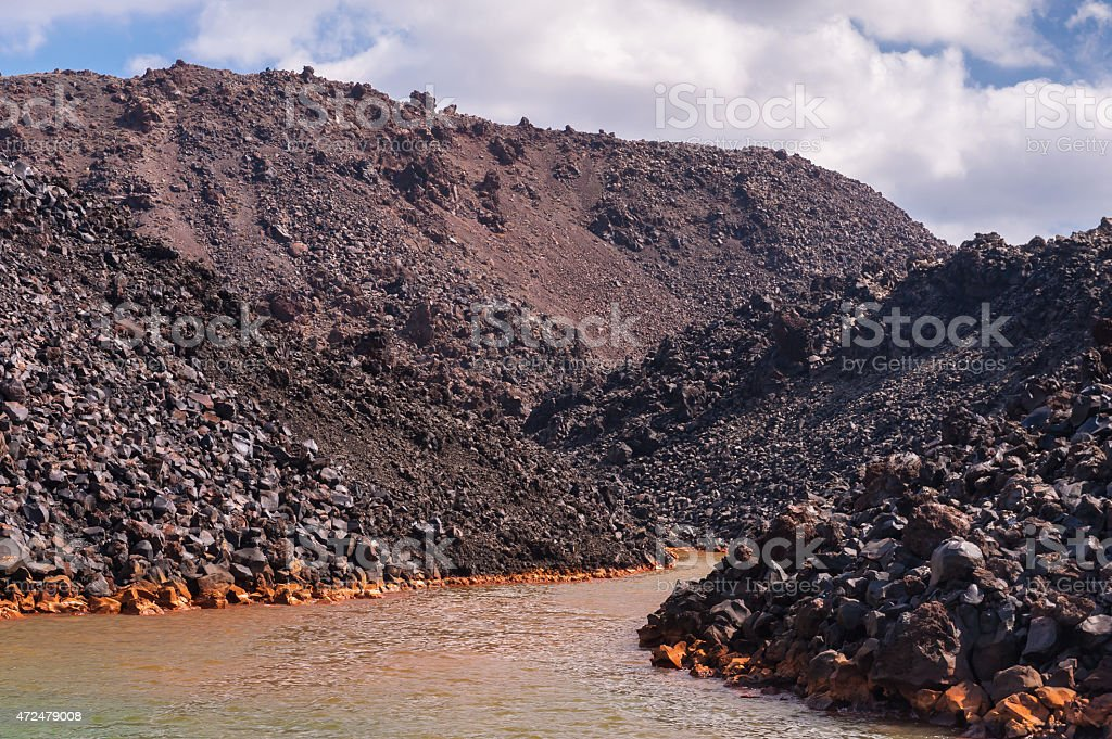 Nea Kameni volcanic island stock photo