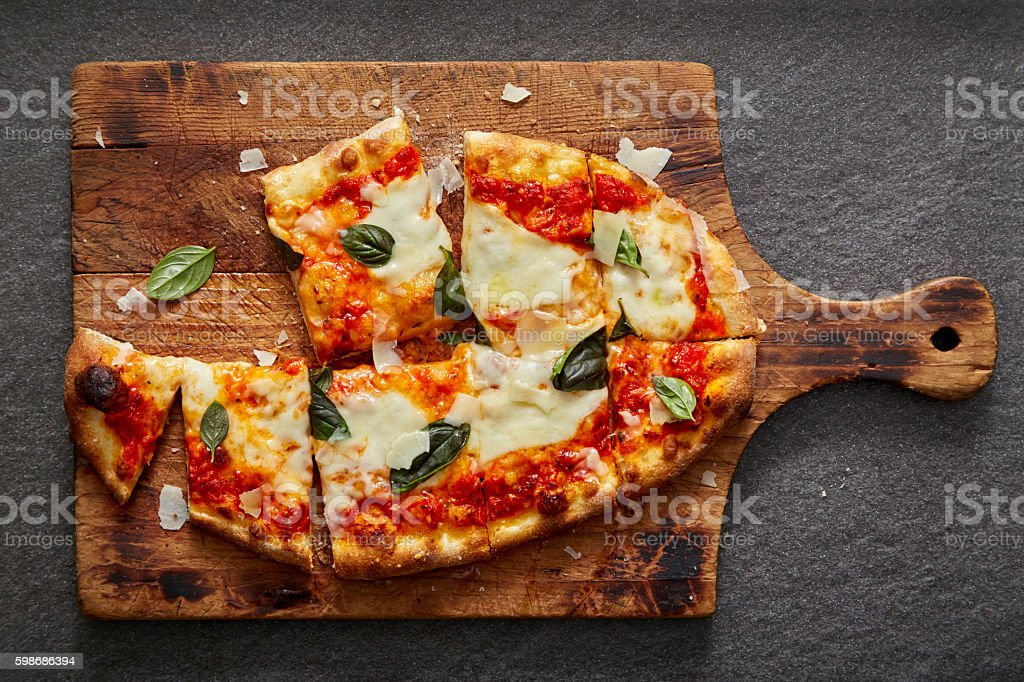 neapolitan pizza on rustic wood and stone stock photo