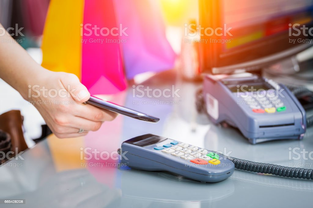 Near field communication (NFC) mobile phone payment. stock photo