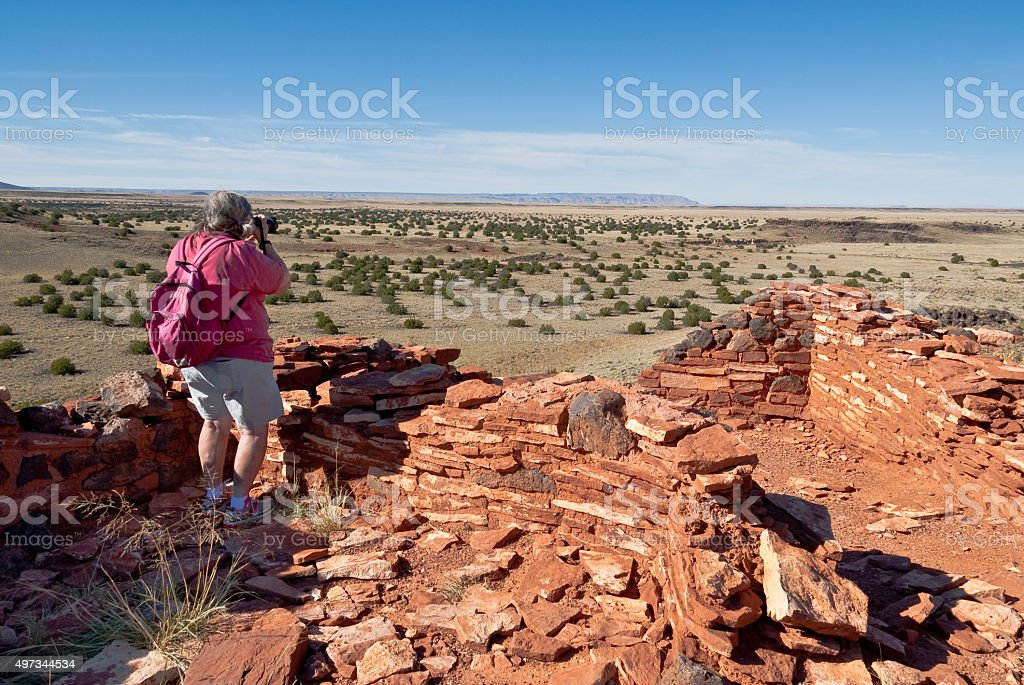 Woman Taking a Picture at Citadel Mesa stock photo