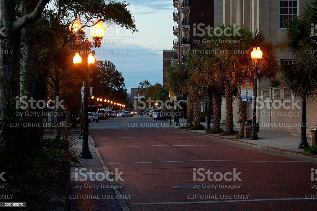 Nearly empty old street dimly lit at dusk in Wilmington stock photo