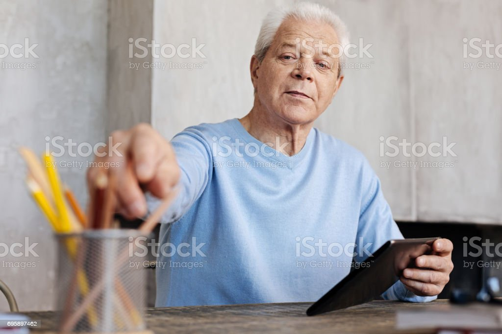 Neat classy writer taking a pencil stock photo