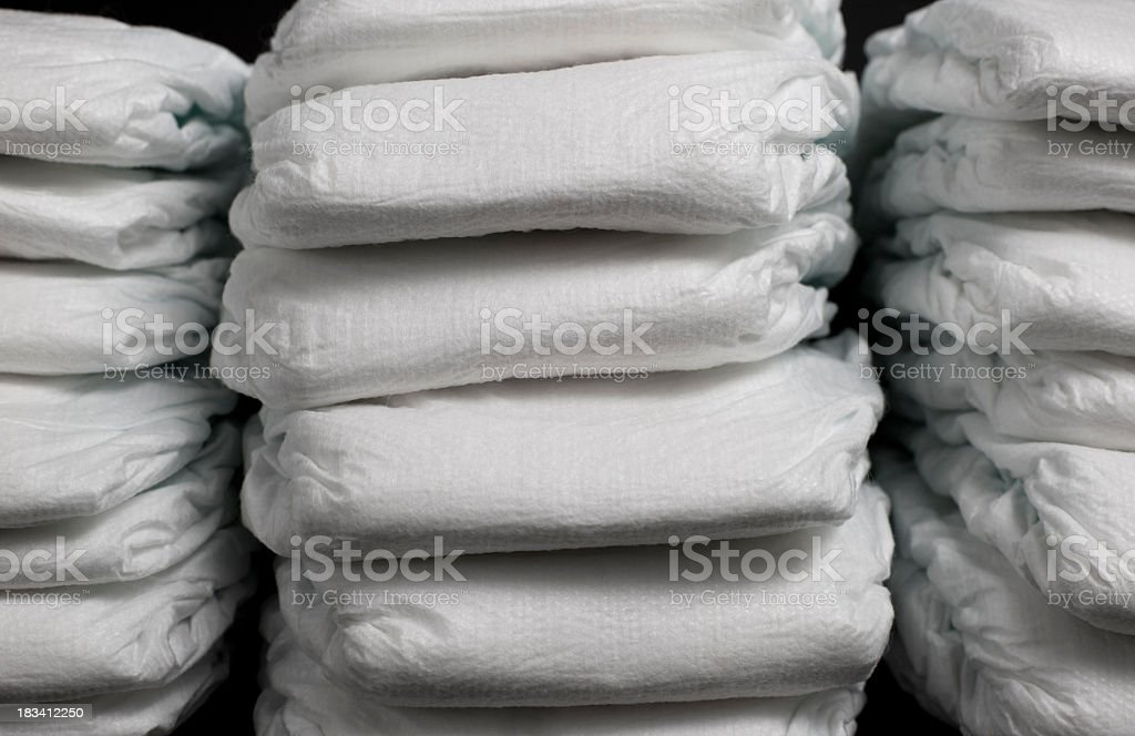 Neat piles of disposable diapers stock photo