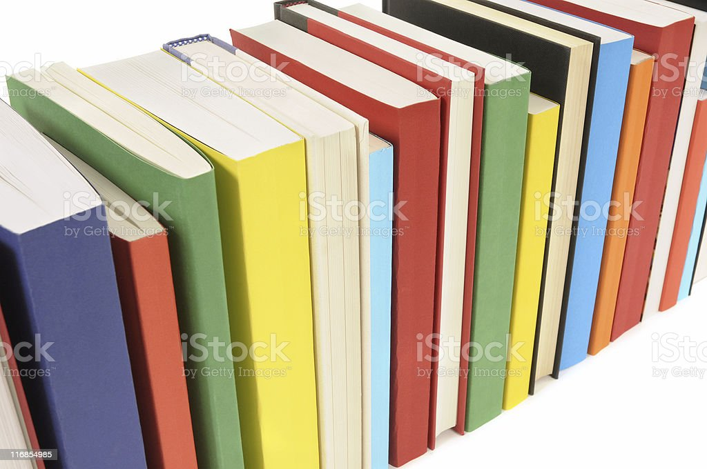 Neat row of colorful paperback books royalty-free stock photo