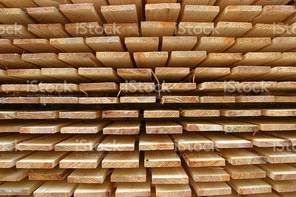 Neat stacks of wood deck planks stock photo