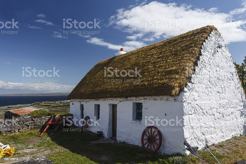 Neat whitewashed Irish cottage on the island of Inishee stock photo