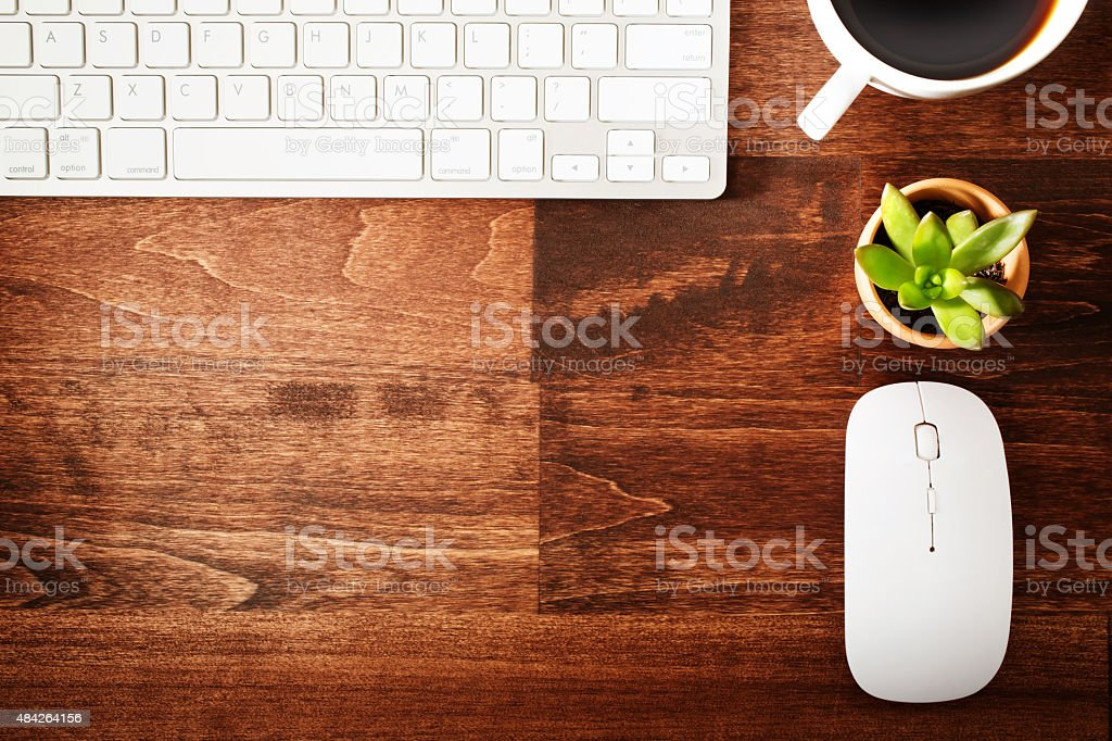 Neat workstation on a wooden desk stock photo