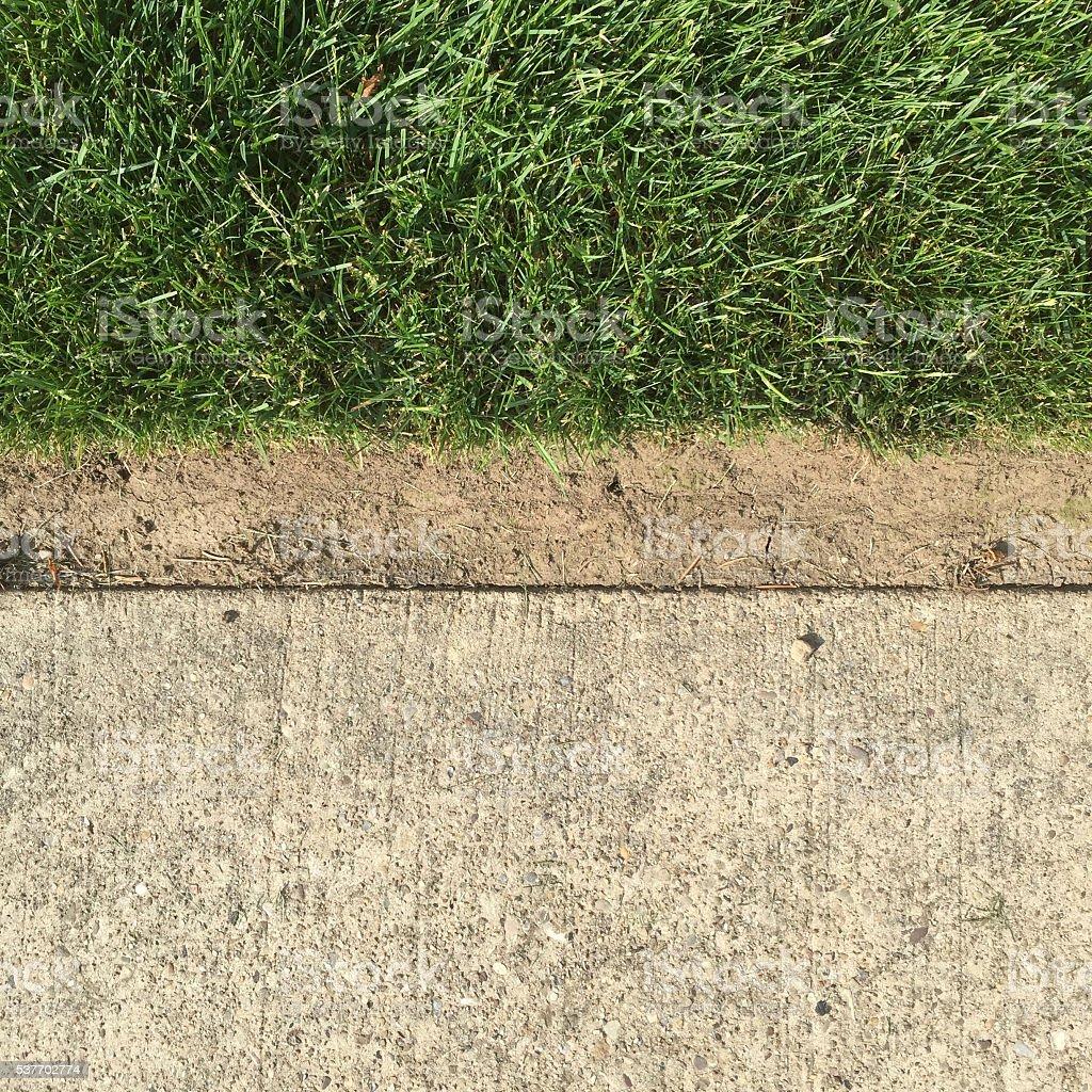 Neatly Edged Grass along Sidewalk stock photo