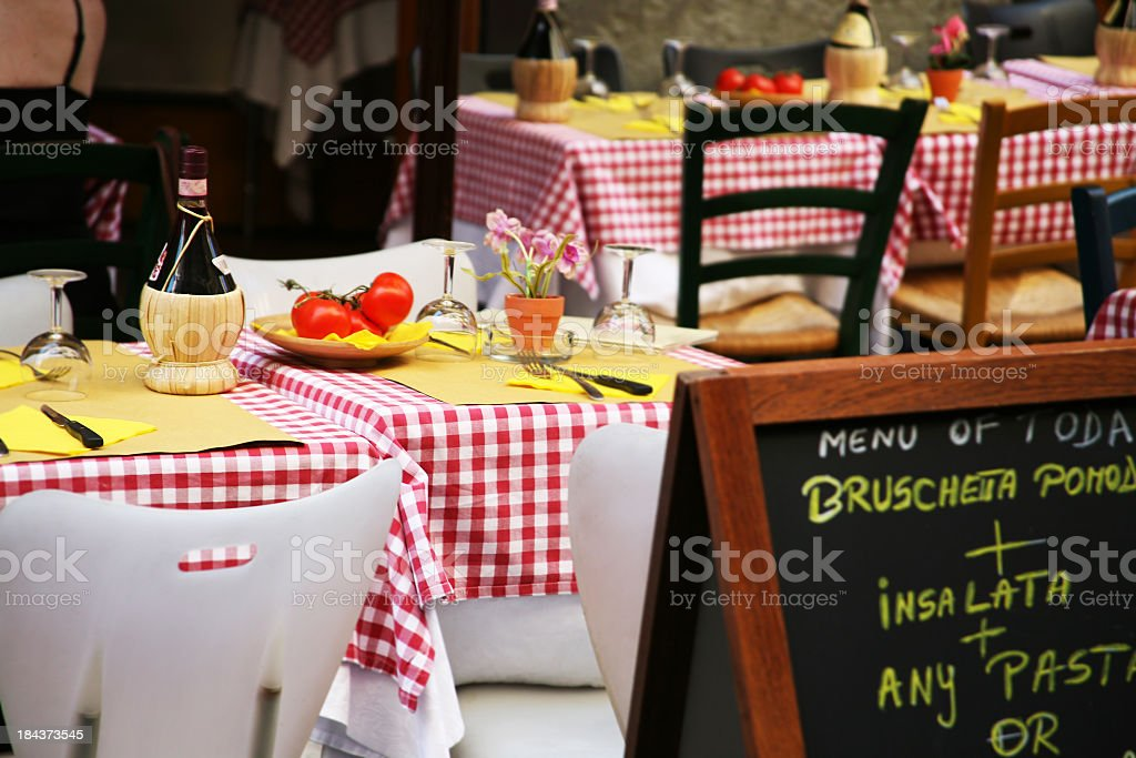 Neatly presented tables in an Italian restaurant stock photo