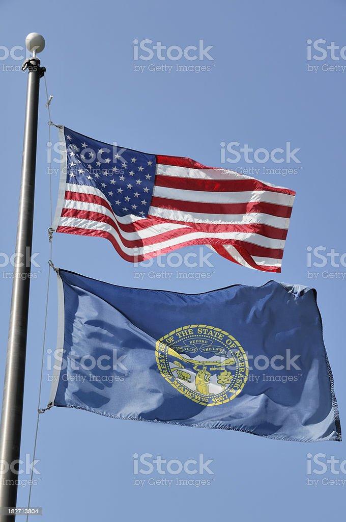 Nebraska and US Flags royalty-free stock photo