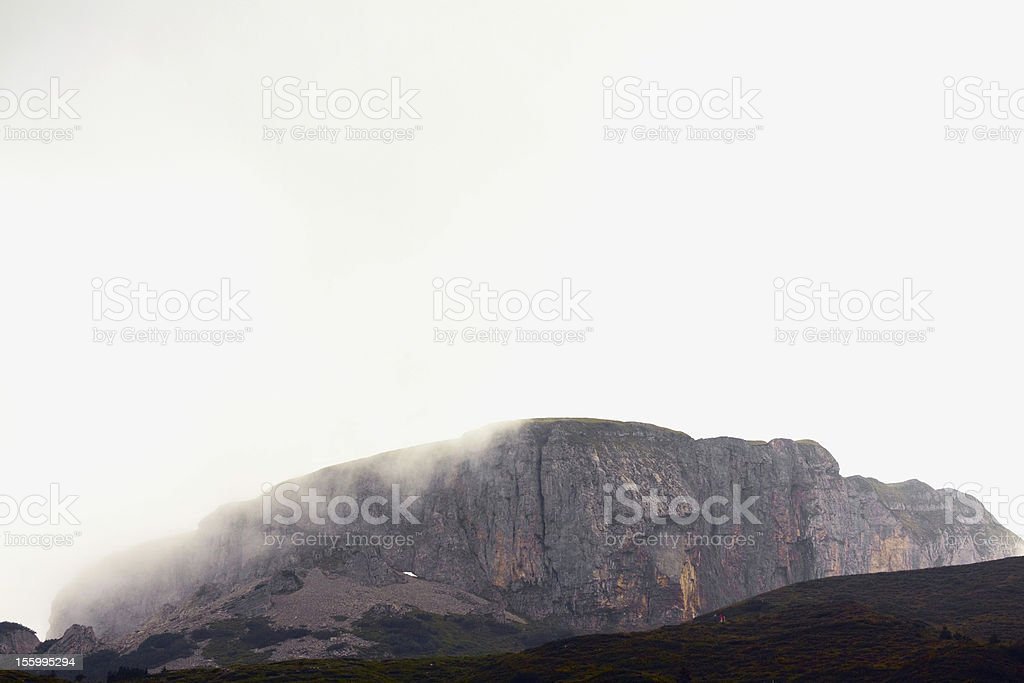 Nebulous Alpines: trekking in fog stock photo