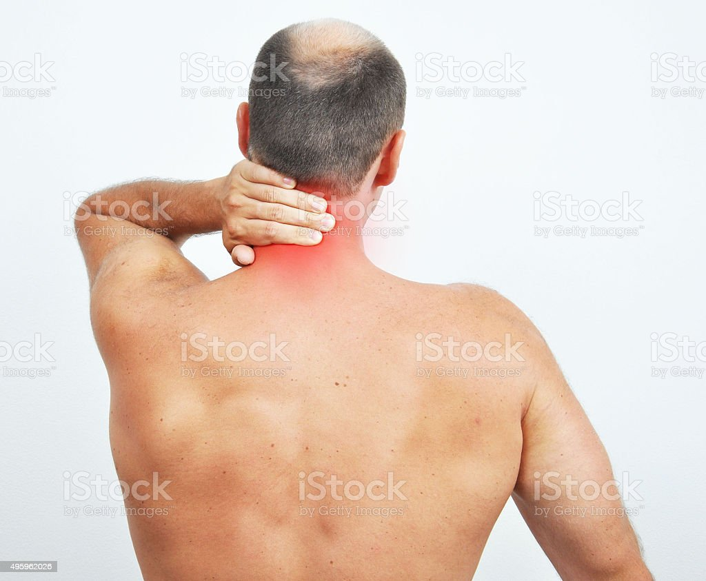 Man with an ache in neck on white background