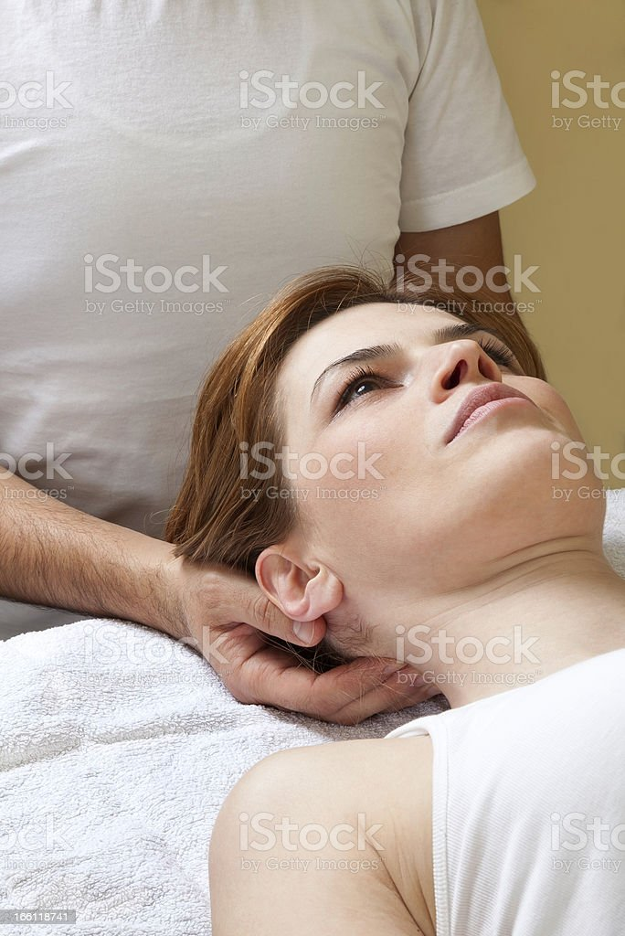 Neck and head massage of woman stock photo