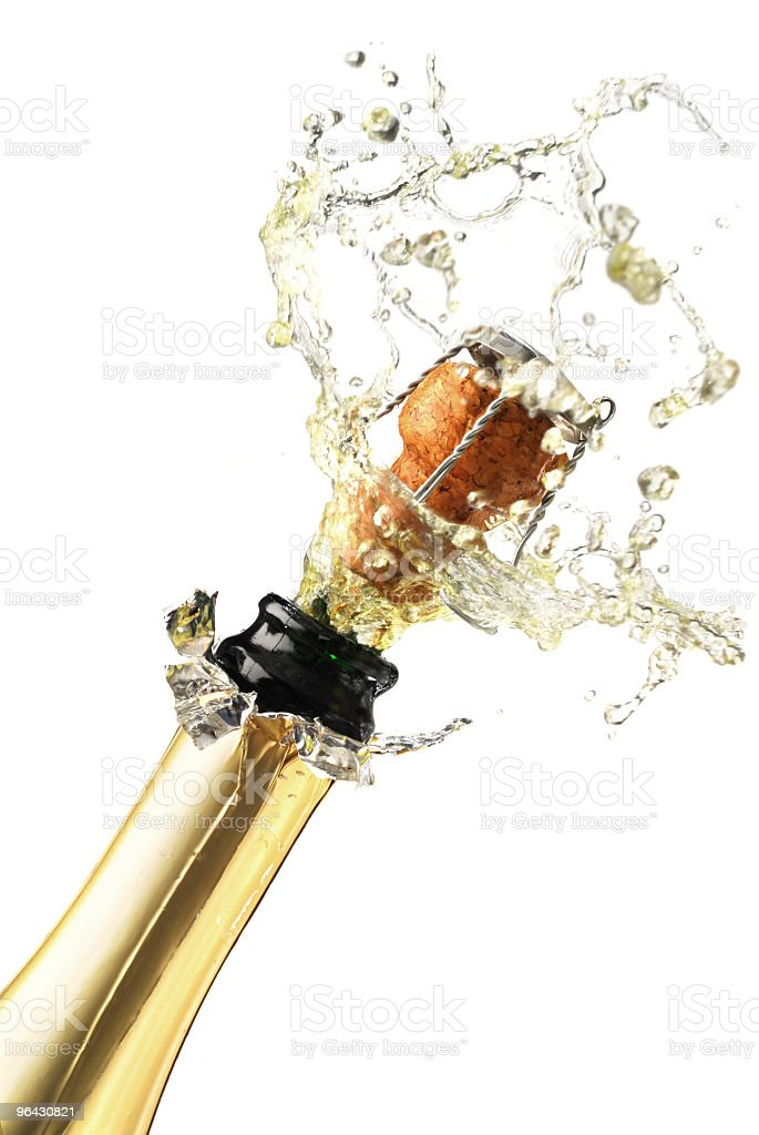 Neck of champagne bottle with cork and bubbles coming out royalty-free stock photo